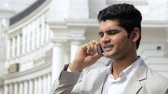 Shaky shot of a businessman talking on a mobile phone Stock Footage