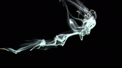 Slow-Mo. Real incense. Sucked with vaccume. Stock Footage