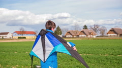 Walking with wind kite on back 4K Stock Footage