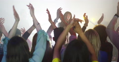 4K Young crowd at live music event, listening to the band and dancing - stock footage