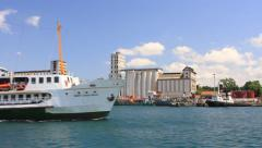 City passenger ship cruising in front of port granary Stock Footage