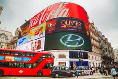 Piccadilly Circus junction crowded by people in London - stock photo