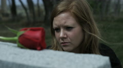 Stock Video Footage of slow motion somber girl visiting grave stone in cemetery