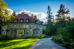 Walkway and the Pittock Mansion, at Pittock Acres Park, in Portland, Oregon. - stock photo