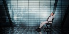 Stock Illustration of Composite image of businessman relaxing in swivel chair