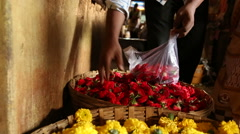 Young Indian vendor taking products in a bag at market in Goa. Stock Footage