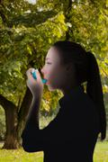 Composite image of beautiful blonde using an asthma inhaler - stock photo