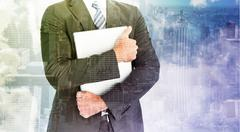 Composite image of businessman holding his laptop tightly Stock Illustration