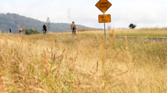 Leisure cyclist on country highway after new safe passing distance laws Stock Footage