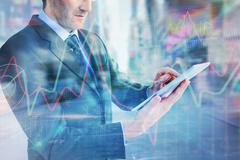 Stock Illustration of Composite image of mid section of a businessman using digital tablet