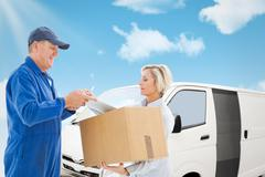 Composite image of happy delivery man with customer - stock photo