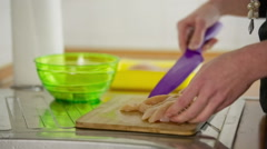 Slicing raw chicken meat on desk in kitchen Stock Footage