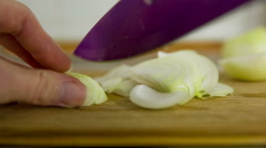 Slicing onion to small pieces personal view Stock Footage