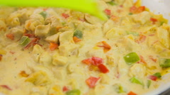 Dish sauce with meat and vegetables boiling close up Stock Footage