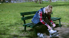 Girl sitting on the bench and wearing rollerblades - stock footage