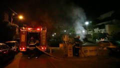 Firefighters extinguish fire in garbage container during Lag Baomer Stock Footage