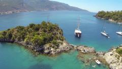 Flying over cruise yachts anchored at blue lagoon. Oludeniz Beach, Turkey Stock Footage