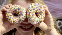 Silly Teen Girl Pretends She Has Donuts For Eyes, She Smiles And Laughs (4K) Stock Footage