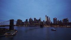 Nice evening shot of Manhattan downtown skyline with Brooklyn Bridge Stock Footage
