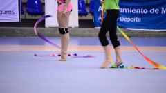 Young gymnasts practicing in court in rhythmic gymnastics tournament - stock footage