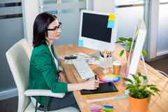 Designer working with colour wheel and digitizer - stock photo