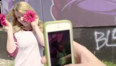 Teen Poses With Flowers In Front Of Her Eyes, Her Friend Takes A Photo (4K) Stock Footage