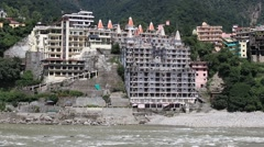 Holy Ganges river that flows through Rishikesh  the world capital of Yoga, India Stock Footage