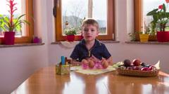 Boy preparing decorating eggs looking in camera 4K Stock Footage