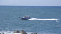 Speeding police patrol boat Stock Footage