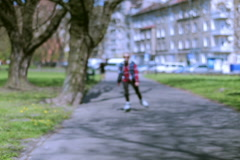 Girl riding on rollerblades in the park and smiling to the camera - stock footage