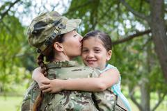 Soldier reunited with her daughter - stock photo