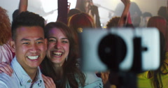 4K Young couple at live music event pose to take a selfie with camera phone Stock Footage