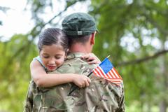 Soldier reunited with his daughter - stock photo