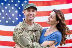 Handsome soldier reunited with partner - stock photo
