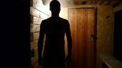 Man's silhouette on a sauna porch after bath Stock Footage