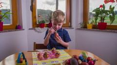Kid enjoy drawing on egg 4K Stock Footage