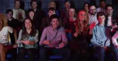 4K Young theatre audience give a standing ovation to the performers on stage Stock Footage