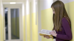 Turning pages of book reading on corridor 4K Stock Footage