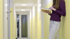 Person stand on corridor and read a yellow book 4K Stock Footage
