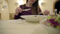 Person using fork and knife for slicing meal 4K Stock Footage
