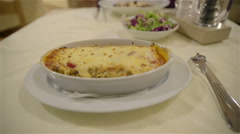Served boiling lasagna dish on table 4K Stock Footage