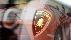 Detail of logo (wheel) - Lamborghini - backlight and side of car Stock Footage