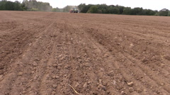 Stock Video Footage of tilt up country field on plowing tractor in summer time