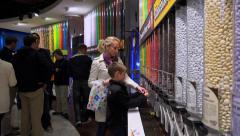 Buyers and M&Ms candy in the M&M's World store  at Times Square - stock footage