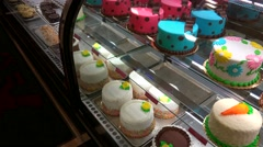 Variety of cakes in the showcase of a bakery. Stock Footage