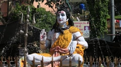 Statue Shiva with a fountain of the sacred Ganges River. Rishikesh, India Stock Footage