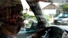 Old man(senior) drives a car - head - urban street with passing cars - people Stock Footage