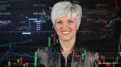 Business middle aged woman smiles - financial market (exchange) - graph Stock Footage