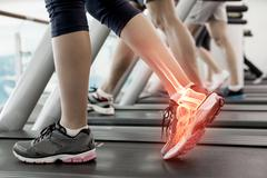 Stock Illustration of Highlighted ankle of woman on treadmill