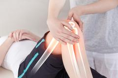 Highlighted bones of woman at physiotherapist - stock illustration